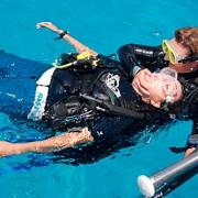 rescue diver course from PADI. A diver help another diver with health problems, to come out safely from the water