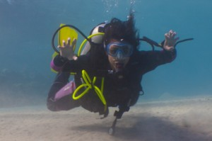Sara scuba diving with her scuba diving equipment in Egypt mastering her buoyancy