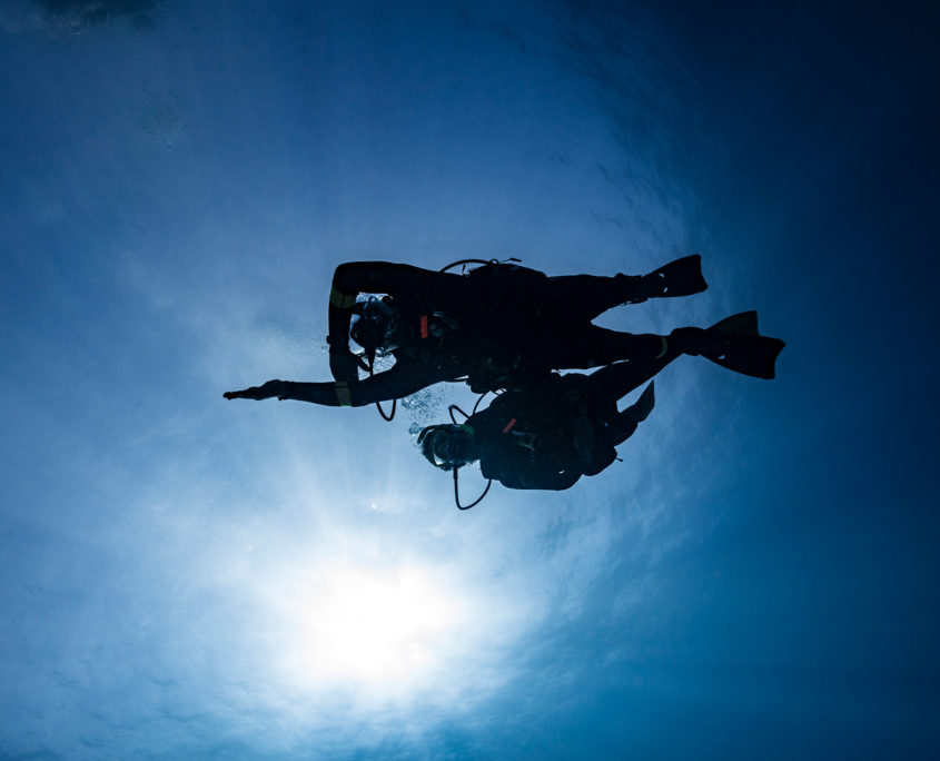 open water divers in Malaga, learning how to navigate  during the open water diver course.