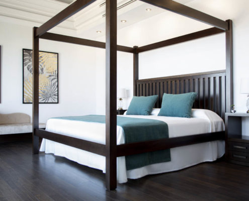 La Hacienda vistamar room with a bed, pillows and beautiful decorations, located in Nerja