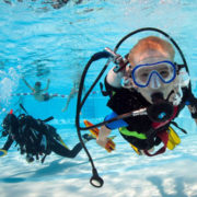 bubblemaker course, kids learning how to scuba dive in a swimming pool, with the supervision of  a diving instructor